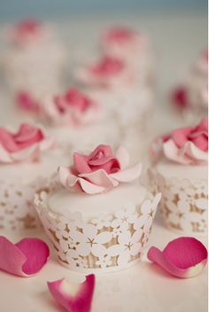 Pretty rose-themed cupcakes - what else would you want for a country garden wedding?