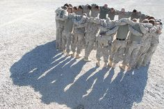 Soldiers with Kash Alvaro's unit, the 4th Engineer Battalion, pray before a mission conducted the day after their convoy was hit by three roadside bombs.