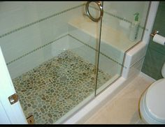 Bathroom ideas - stones with just a little roundness to them feel like a little massage on your feet.