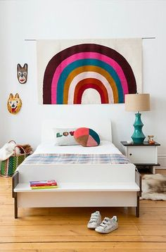 """This rainbow will brighten any room. 100% wool hand-loomed flat-weave rug. Features - Made in Peru - Available in 2 sizes: 36"""" x 60"""", 48"""" x 72"""""""