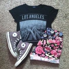 For an edgy with slight girly vibes, wear a graphic tee with a pair of floral shorts and converse.