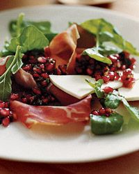 Serrano Ham and Arugula Salad with Pomegranate Salsa - This vibrant dish, layered with arugula, bright white slices of ricotta salata and strips of salty serrano ham, is the sort of composed salad that Suzanne Goin uses to showcase seasonal ingredients. Another of her favorite winter salads is made with blood oranges, dates and Parmesan cheese