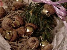 Jingles Bells in Acorn caps ~ maybe glitter the caps and hang as an ornament or use as pkg decorations.
