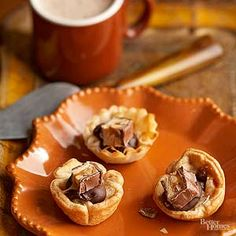 These adorable tartlets taste like a chocolatey candy bar./