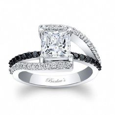 This classic white gold diamond engagement ring features a princess cut moissanite center. The split shank is adorned with diamonds and the shoulders rise up to cradle the center. A black diamond bridge graces the center for an added touch of elegance. Bling Bling, The Bling Ring, Black Diamond Engagement, Black Diamond Wedding Rings, Solitaire Engagement, Wedding Engagement, Princess Cut Diamonds, Diamond Are A Girls Best Friend, White Gold Diamonds