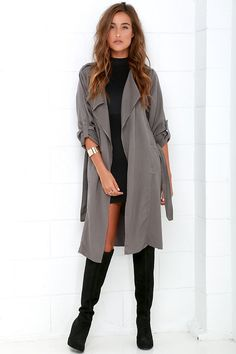 When you're looking to bundle up in style, let the Black Swan Emma Dark Grey Trench Coat be your go-to! This lightweight woven coat holds all of your favorite trench coat features, starting with shoulder epaulettes, and long cuffed sleeves that can be worn rolled up with button-tabs. The notched collar, alongside a breast patch pocket, falls to a dreamy open front that secures with a tying sash belt. Vertical welted pockets, kick pleat and two side slits finish the look. Unlined. 100%…