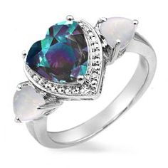This is the PERFECT engagement ring! Opal is for october (the month i wish to be married) and the other gem is for june (my boyfriends birth month) which according to supperstition, getting married the same week of your fiances birthday is good luck! :D