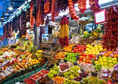 Visit Mercat de la Boqueria for a more local shopping experience and sample the delicious fresh fruit, meat, fish, and cheeses for sale.