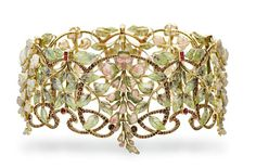 """Glycines"""" (""""Wisteria"""") dog collar by Philippe Wolfers, 1902, with plique à jour enamel, carved tourmalines and opals, rubies, garnets and Baroque pearls at Christie's Geneva, May 18, 2016 (photo: Christie's Images)"""