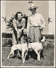 """""""Mr. & Mrs. Irvey Ownbey pose with their two prize birddogs."""" May 24, 1949. Photographer: Bob East.  Location of source: """"The Gateway to Oklahoma History"""" (Online)."""