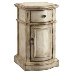 """Hand-painted end table with a lower cabinet.Product: End table Construction Material:  Wood Color: Weathered tan  Features:   One door One drawer  Hand-painted  Dimensions: 25"""" H x 18"""" W x 14"""" D"""