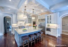 A gorgeous open #kitchen with island bar seating and a coffered ceiling. The Carrera #1178. http://www.dongardner.com/house-plan/1178/the-carrera. #IslandKitchen #DreamHome