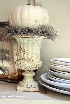 love this display... urn, pumpkin, moss... perfect!