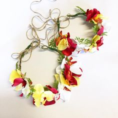 Beautiful Hawaiian multi colored flowers made to order on halo style band