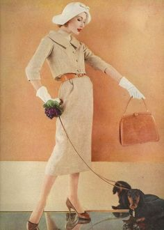Photo by Karen Radkai for Vogue, November 1958.  Hat, purse, flowers, dog; all the accessories a lady needs.