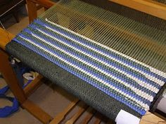 """Daisy Hill Weaving Studio: Stash Reduction Rag Rugs - a commenter says -  I don't sew rag strips. I cut the ends at a 45 to 60 degree angle and just overlap them. Denim has been the most popular rag. I started using 1"""" strips and reduced that to 3/4"""" to smooth out the selvage. Have the most fun with knit shirts. There I use 1/2"""" strips and get a blanket weight product. Nice mats and runners and light weight rugs."""