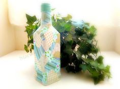 When the party was over, this Tequila bottle settled down to become a quaint country bud vase.