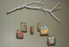 i made this! me. zoe. zoe made this. it's the owl mobile i made for milo (inspired by a similar one i found on etsy), that's still hanging above his crib because i'm a genius and i hung it way too high so that he won't be able to reach it till he's 16.