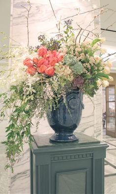 sweet pea floral design Detroit institute of art cobalt stone urn vase filled with hawaiian orchids, coral roses, privet berries parrot tulips rice flower, quince branches jasmine vine wedding flowers michigan wedding florist extra large floral design esc