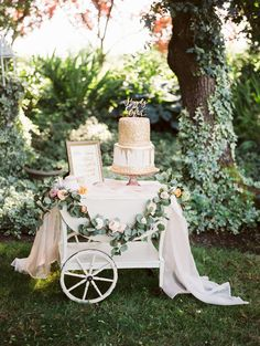cake table cart dressed up in flower garland