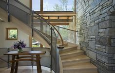 contemporary-stone-farmhouse-with-aged-wood-siding-segments-9-staircase.jpg