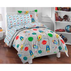 @Overstock - This Space Rocket ultra-soft microfiber comforter set features space rockets, stars, planets and comets in an array of multi-colors.  The printed fabric comforter and sham reverse to a solid grey.   http://www.overstock.com/Bedding-Bath/Space-Rocket-Twin-size-Bed-in-a-Bag-with-Sheet-Set/7316038/product.html?CID=214117 $39.99