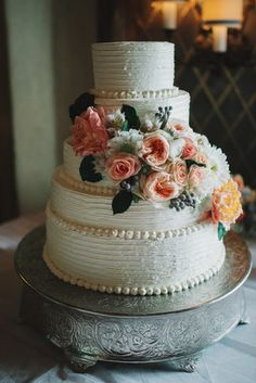 Combed buttercream cake with lush pink and white flowers @myweddingdotcom