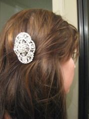 Brooch wired to a comb...to wear after the veil comes off or on the honeymoon