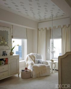 In Ivanka Trump and Jared Kushner's Upper East Side apartment, the nursery's armchair and dresser are by Restoration Hardware Baby & Child, the mohair throw is by Susan Chalom, the chandelier is of Murano glass, and the ceiling is covered in a Sandberg wallpaper.