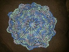 Variegated blue, green and lavender doily