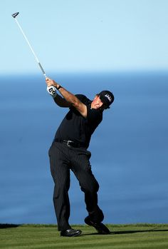 Phil Mickelson hits his tee shot on the fifth hole ...