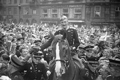 King Christian X on his daily ride through Copenhagen in 1942 during the German occupation of Denmark. When a German asked how the king could do this without a bodyguard, he was told, 'Denmark is his bodyguard.'