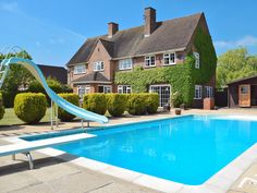 Extensive terracing, south-facing sitting-out areas and an outdoor heated swimming pool.