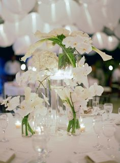 All-White Centerpieces | Elizabeth Messina Photographs https://www.theknot.com/marketplace/elizabeth-messina-photographs-santa-monica-ca-366507