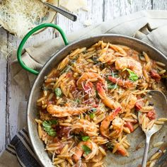 An easy and delicious one pot recipe. Juicy shrimp cooked in a tomato and balsamic broth and mixed with orzo pasta.