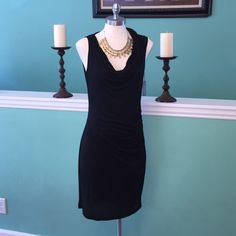 Velvet dress Velvet dress brand-new with tags's. SZ medium scoopneck  at lower half. 97% rayon 3% spandex dryclean only. In perfect condition. Great for all seasons. Dress up or dress down and double lined. Can't go wrong with a black cocktail dress for any type of function or occasion. Velvet Dresses Midi