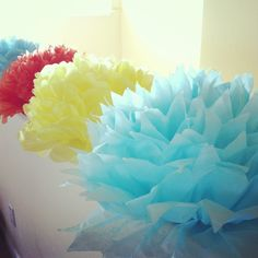 Create beautiful tissue paper flowers following simple steps here. Discover this and more crafts for kids.