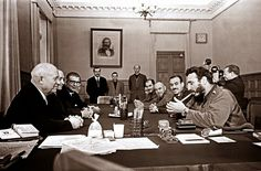 Fidel Castro lighting a cigar and wearing two Rolex watches during a meeting…