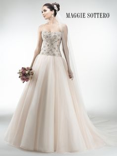 Maggie Sottero - LOURDES, Stunning Chic organza ball gown accented with exquisite, heavily beaded Swarovski crystal bodice and sweetheart neckline. Crystal buttons adorn a zipper over inner corset closure.