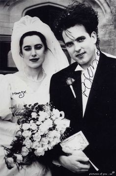 Robert Smith and his wife Mary Poole.  They are still together after all these years.  Just love that.