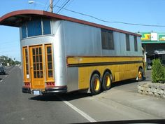 School bus conversion camper. It's different but cool too, like to see it when it's finished.