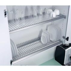 A Cupboard above sink, with no base, so that wet dishes can drip dry and are already put away