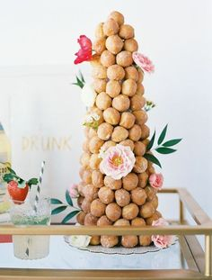 Another alternative is a croque-en-bouche. This is actually a French dessert consisting of choux pastry balls (or doughnuts) piled into a cone and bound with threads of caramel. In Italy and France, it is often served at weddings, baptisms, and first communions. Learn how to make your own croqu en-bouche tower over Oh Happy Day. You can see this entire set up on Design Love Fest Designed by Grit + Gold and photographed by Ben Q Photography.