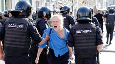 A Russian group that monitors police arrests says nearly people were detained in a police crackdown on an opposition protest in Moscow, the largest number of detentions at a protest in the Russian capital this decade.