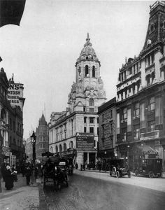 "Lost London - Page 7 - SkyscraperCity    Bottom end of Tottenham Court Road, looking north.  The magnificent old building on the corner of Great Russell Street was destroyed in the war. The ""Horse Shoes"" can be seen on the right."
