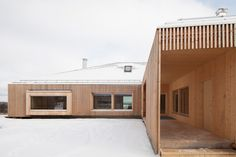 OOPEAA arranges house riihi around courtyard in finnish countryside