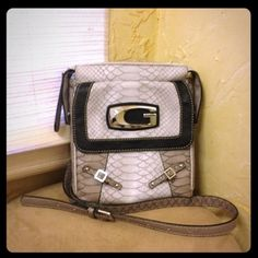 """leather Guess cross-body Adjustable leather cross-body, black, pewter and light gray with silver hardware, multi-pocket, zipper closure on top and snap in front, excellent condition except tiny scuff on """"G"""" hardware on front (hardly noticeable), never used, was a birthday present and I love it- just couldn't make it work for me Guess Bags Crossbody Bags"""