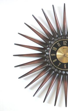 Mid Century Modern Syroco Starburst Wall Clock from The Vintage Resource on Etsy
