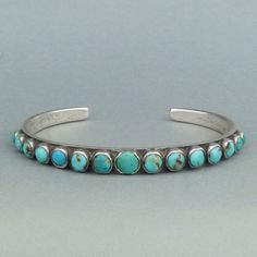 Navajo Silver Row Bracelet with Fifteen Turquoise Cabochons, c.1940's | Shiprock Santa Fe