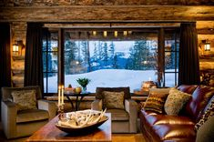 OSM | Architect: Pearson Design Group | Mirror Pond | Living Room | Location: Big Sky, MT | The home has an authentic Rocky Mountain feel with rustic modern appeal. It reflects its natural setting and blends into the surrounding wilderness.